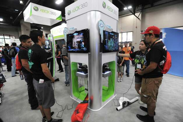 "People try their hand at ""Halo 4"" on the XBox 360 during the GameStop Expo at the Convention Center. The game is among those expected to sell well. Photo: Billy Calzada, San Antonio Express-News / © San Antonio Express-News"