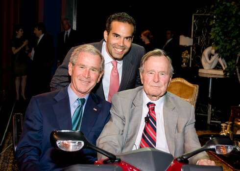 George W. Bush, from left, George P. Bush and George H.W. Bush had a moment onstage together at A Celebration of Reading, Barbara Bush's annual fundraiser for literacy causes. (David Shutts / David Shutts)