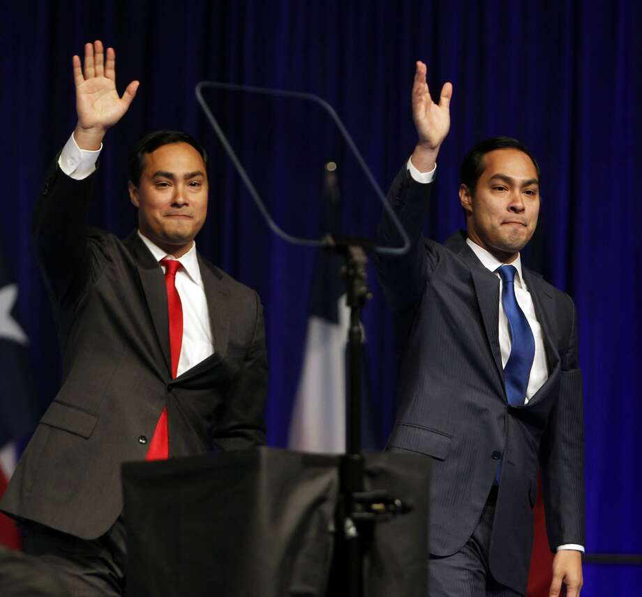 Joaquin Castro left, introduces his twin brother and San Antonio Mayor Julian Castro during the the 2012 Texas Democratic Party State Convention June 8, 2012, in Houston. (James Nielsen / Houston Chronicle)
