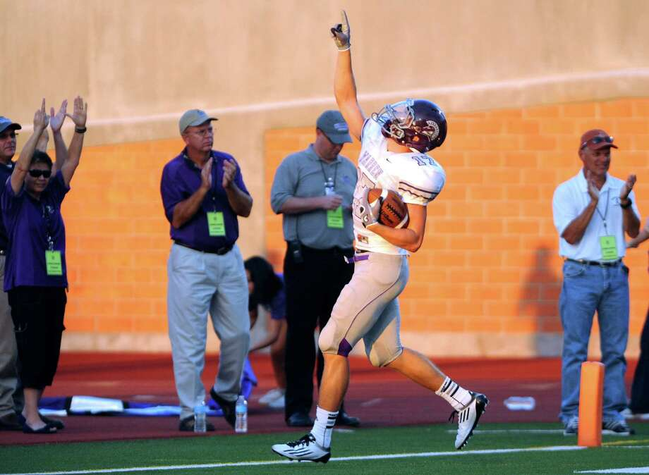 Aron Taylor of Warren points skyward after scoring a first-half touchdown against MacArthur during high-school football action at Heroes Stadium on Thursday, Aug. 30, 2012. Photo: Billy Calzada, San Antonio Express-News / © San Antonio Express-News