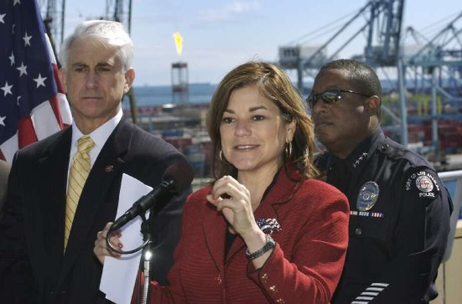 U.S. Rep. Loretta Sanchez, D-Calif., talks about port security measures during a news conference at the Port of Long Beach in Long Beach, Calif., Thursday, Feb. 22, 2007, as Dave Reichert, R-Washington, left, and Los Angeles Port Police Chief Ronald Boyd listen. More money is needed to safeguard the nation's ports, three ranking members of congressional committees on terrorism and security said Thursday. (AP Photo/Long Beach Press-Telegram, Steven Georges) ** MAGS OUT, INTERNET OUT, NO SALES ** (Steven Georges / AP)
