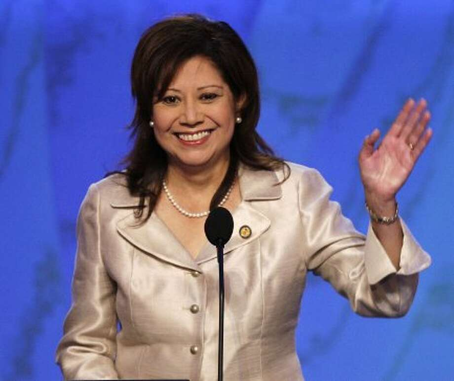 ** FILE ** In this Aug. 27, 2008 file photo, Rep. Hilda Solis, D-Calif., waves as she speaks at the Democratic National Convention in Denver. Solis, the 51-year-old daughter of a Mexican union shop steward and a Nicaraguan assembly line worker, is in line to be the second Hispanic nominee in Obama's Cabinet. Obama planned to announce her nomination as secretary of labor  Friday.   (AP Photo/Ron Edmonds, File) (Ron Edmonds / AP)