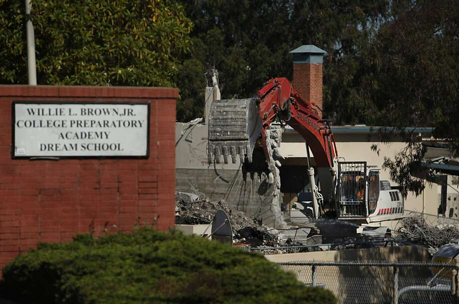 An excavator carries rubble as the Willie L. Brown Jr. College Preparatory Academy Dream School is demolished on Wednesday, August 29, 2012 in San Francisco, Calif. Photo: Lea Suzuki, The Chronicle