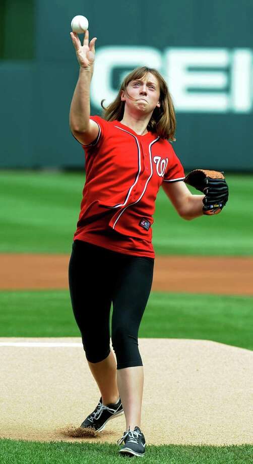 Katie Ledecky, 15-year-old gold medalist in the women's 800-meter freestyle competition at the 2012 London Summer Olympics, tosses out the ceremonial first pitch prior to a baseball game between the Chicago Cubs and Washington Nationals at Nationals Park, Monday, Sept. 3, 2012, in Washington. (AP Photo/Richard Lipski) Photo: Rich Lipski, Associated Press / FR170623 AP