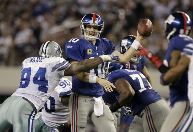 New York Giants quarterback Eli Manning (10) is pressured by Dallas Cowboys outside linebacker DeMarcus Ware (94) during an NFL football game Sunday, Dec. 11, 2011, in Arlington, Texas. The Giants won 37-34. (AP Photo/Tony Gutierrez) (Associated Press)