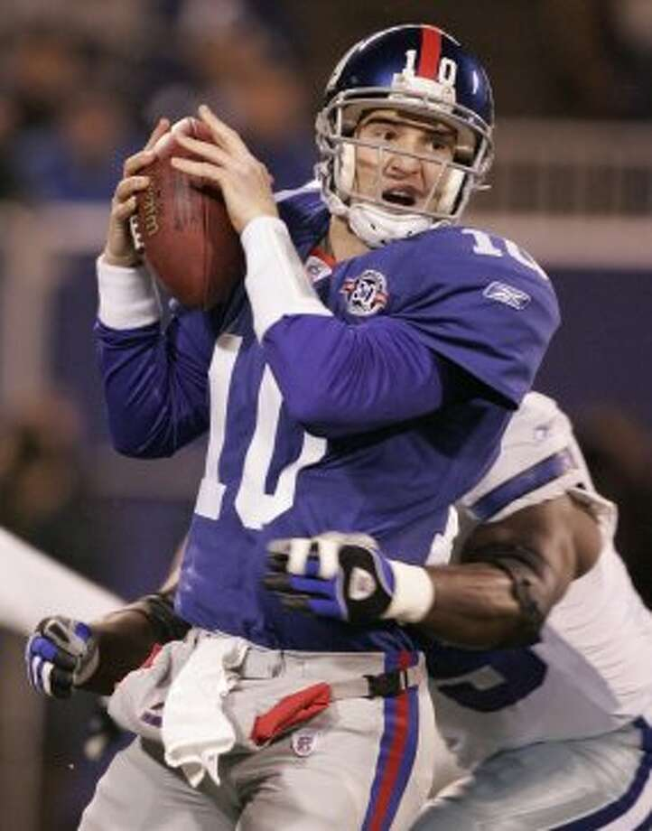New York Giants' Eli Manning is hit for a sack by Dallas Cowboys' Marcellus Wiley during the first quarter Sunday, Jan. 2, 2005 in East Rutherford, New Jersey. (AP Photo/Julie Jacobson) (AP)