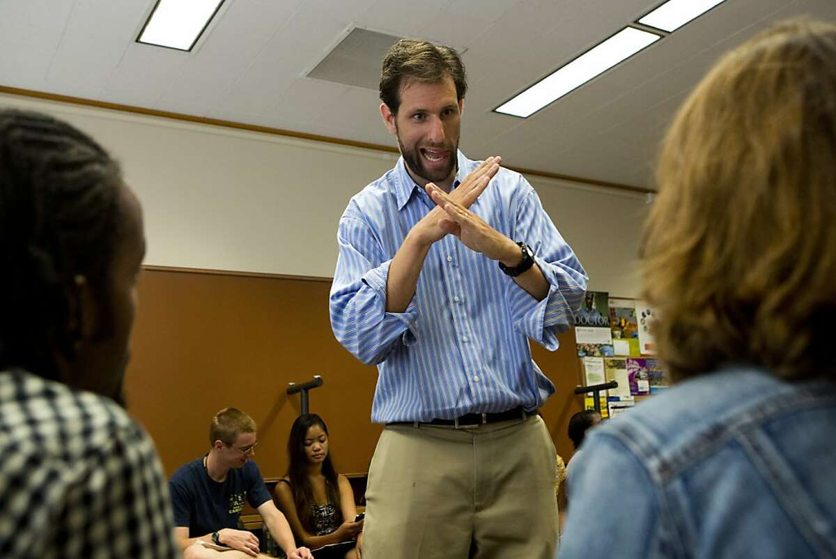 Joel Serg, consultant to the Bill and Melinda Gates Foundation, works one-on-one with fellows of the Global Citizen Year during the first week of the Bridge Year Program that is designed to prepare the fellows for their work overseas at Stanford University on Thursday, August 23, 2012 in Palo Alto, Calif.