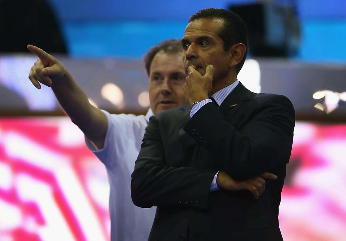 CHARLOTTE, NC - SEPTEMBER 01: Los Angeles Mayor Antonio Villaraigosa (R) tours the stage as preparations continue at the Time Warner Cable Arena for the Democratic National Convention on September 1, 2012 in Charlotte, North Carolina. The Democratic National Convention is scheduled to run from September 4th - 6th. (Photo by Joe Raedle/Getty Images)