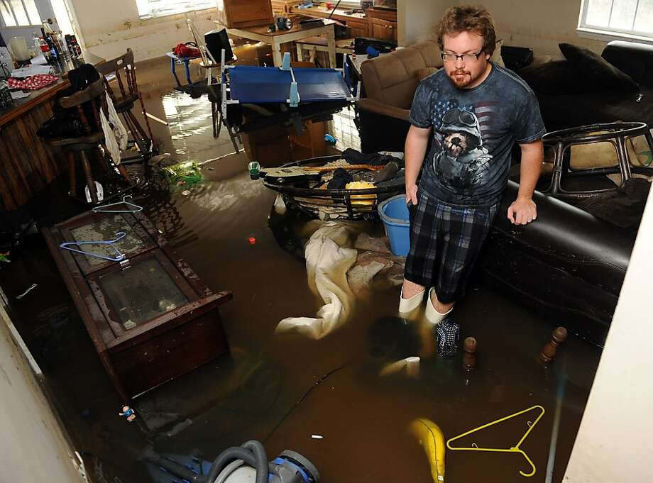 David Horn stands in his living room Monday, Sept. 3, 2012, near Maurepas La. The house is still flooded five days after Hurricane Isaac moved through the area. (AP Photo/ The Advocate, Arthur D. Lauck) Photo: Arthur D. Lauck, Associated Press