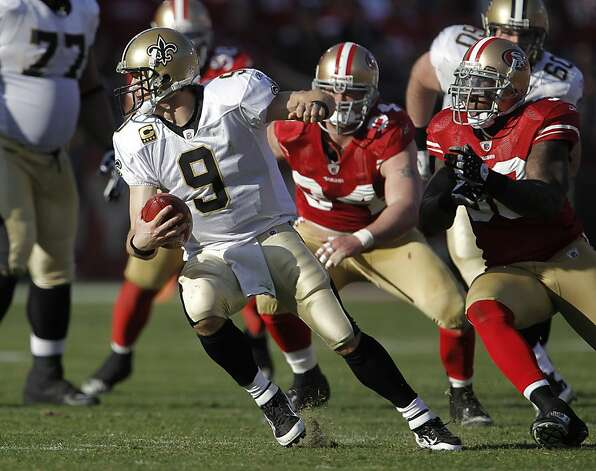 Saints Drew Brees is pressured by Justin Smith, (94) and Parys Haralson(98) in the second quarter, as the San Francisco 49ers take on the New Orleans Saints in the NFC divisional playoffs, on Saturday Jan. 14, 2012, in San Francisco, Ca. Photo: Michael Macor, The Chronicle