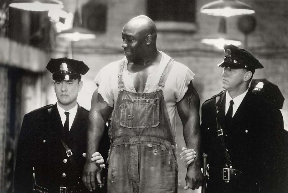 "Bodyguard-turned-actor Michael Clarke Duncan (center) earned an Oscar nomination as best supporting actor for ""The Green Mile,"" co-starring Tom Hanks (left) and David Morse. Photo: Ralph Nelson, Associated Press"