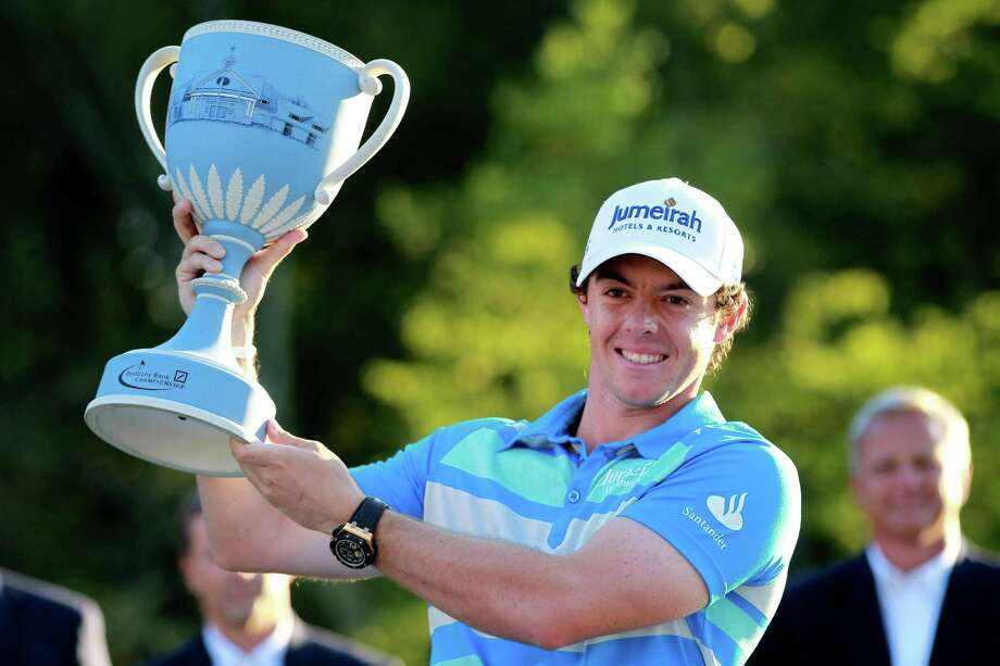 NORTON, MA - SEPTEMBER 03:  Rory McIlroy of Northern Ireland holds up the trophy after winning the Deutsche Bank Championship at TPC Boston on September 3, 2012 in Norton, Massachusetts.  (Photo by Jim Rogash/Getty Images) Photo: Jim Rogash / 2012 Getty Images