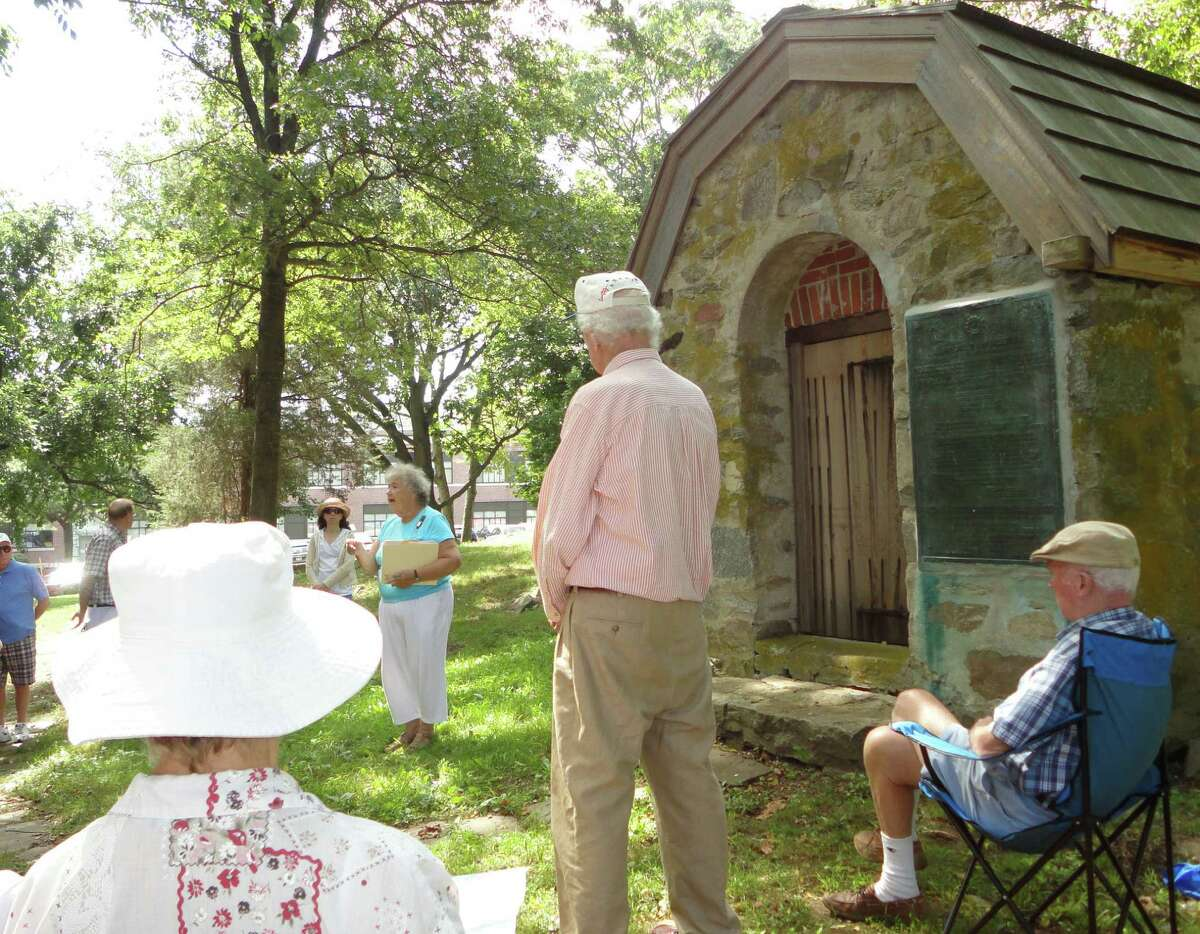 Betty Oderwald, president of the Connecticut State Society, U.S. Daughters of 1812, and a resident of Fairfield, shared information Sunday about the War of 1812 and Fairfield's role in it as she stood in front of a powder house from that era, which is behind Tomlinson Middle School. Oderwald said the Fairfield powder house is the only remaining example in Connecticut of powder houses that were used to store gunpowder and ammunition during early American history.