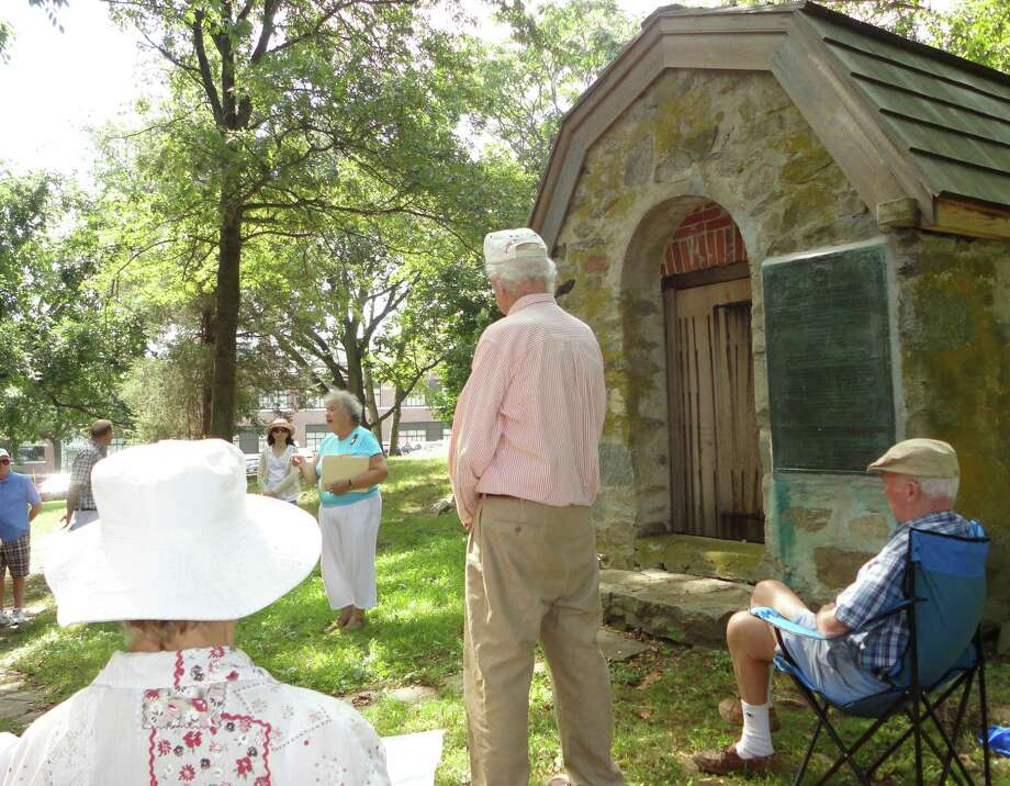 Betty Oderwald, president of the Connecticut State Society, U.S. Daughters of 1812, and a resident of Fairfield, shared information Sunday about the War of 1812 and Fairfield's role in it as she stood in front of a powder house from that era, which is behind Tomlinson Middle School. Oderwald said the Fairfield powder house is the only remaining example in Connecticut of powder houses that were used to store gunpowder and ammunition during early American history. Photo: Meg Barone / Fairfield Citizen freelance