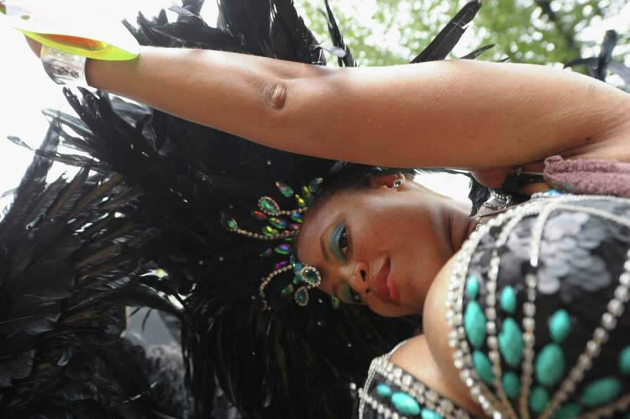 A costumed dancer takes part in the 45th annual West Indian American Day Parade on September 3, 2012