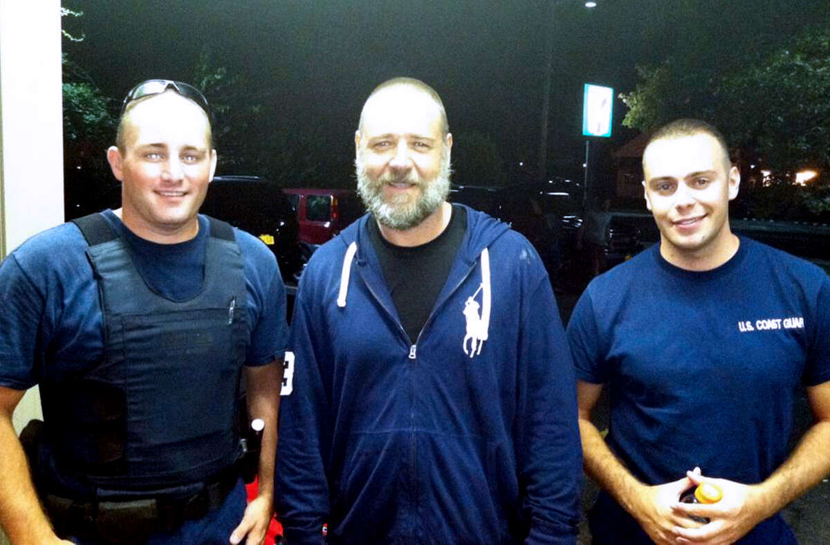 Russell Crowe, center, got a lift from Coast Guard petty officers Robert Swieciki, left, and Thomas Watson after losing his way kayaking.