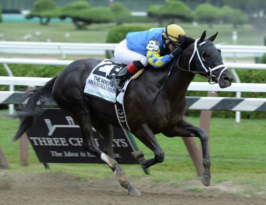 Shanghi Bobby with jockey Rosy Napravnik wins the 108th running of the Hopeful Stakes on the final day of the race meeting at the Saratoga Race Course in Saratoga Springs, N.Y. Sept. 3, 2012.    (Skip Dickstein/Times Union) Photo: Skip Dickstein
