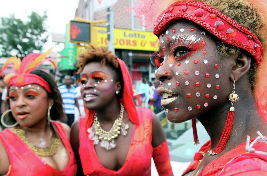 Angelana Jones, right, waits with others to take part in the West Indian Day Parade Monday Sept. 3, 2012 in the Brooklyn borough of New York. (AP Photo/Tina Fineberg) Photo: Tina Fineberg