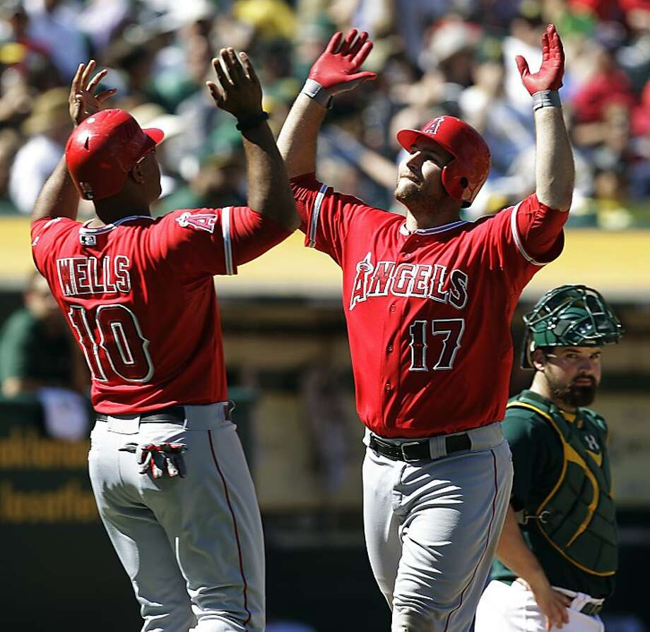 Los Angeles Angels' Chris Ianetta, right, celebrates with Vernon Wells (10) after Ianetta hit a two-run home run off Oakland Athletics' Pedro Figueroa in the sixth inning of a baseball game, Monday, Sept. 3, 2012, in Oakland, Calif. (AP Photo/Ben Margot) Photo: Ben Margot, Associated Press