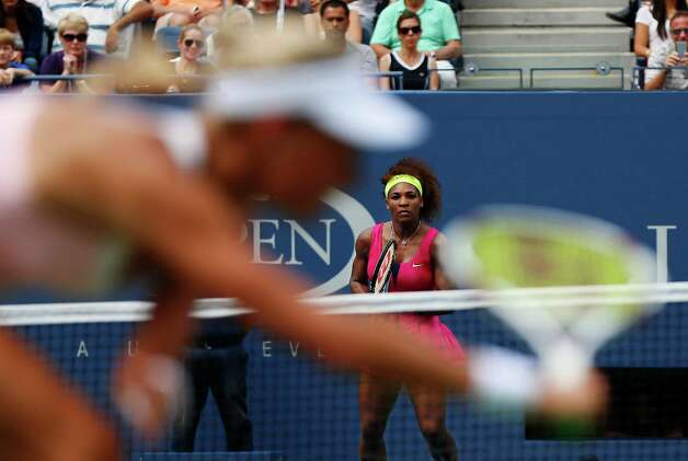 Czech Republic's Andrea Hlavackova returns a shot to Serena Williams in the fourth round of play at the 2012 US Open tennis tournament,  Monday, Sept. 3, 2012, in New York. Williams won the match. (AP Photo/Julio Cortez) Photo: Julio Cortez
