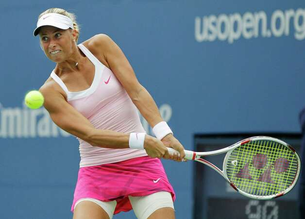 Czech Republic's Andrea Hlavackova returns a shot to Serena Williams in the fourth round of play at the 2012 US Open tennis tournament,  Monday, Sept. 3, 2012, in New York. (AP Photo/Kathy Willens) Photo: Kathy Willens