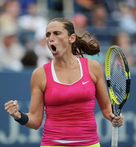Italy's Roberta Vinci reacts during her match against Agnieszka Radwanska, of Poland, in the fourth round of play at the 2012 US Open tennis tournament,  Monday, Sept. 3, 2012, in New York. (AP Photo/Henny Ray Abrams) Photo: Henny Ray Abrams