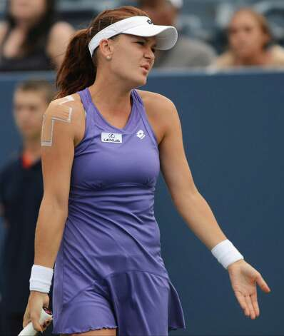 Agnieszka Radwanska, of Poland, reacts during her match against Italy's Roberta Vinci in the fourth round of play at the 2012 US Open tennis tournament,  Monday, Sept. 3, 2012, in New York. Radwanska lost the match. (AP Photo/Henny Ray Abrams) Photo: Henny Ray Abrams