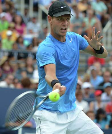 Czech Republic's Tomas Berdych returns a shot to Spain's Nicolas Almagro in the fourth round of play at the 2012 US Open tennis tournament,  Monday, Sept. 3, 2012, in New York. Berdych won the match. (AP Photo/Henny Ray Abrams) Photo: Henny Ray Abrams