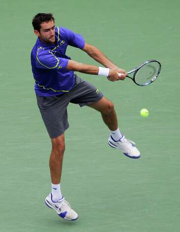 Marin Cilic, of Croatia, returns a shot to Slovakia's Martin Klizan in the fourth round of play at the 2012 US Open tennis tournament,  Monday, Sept. 3, 2012, in New York. (AP Photo/Kathy Willens) Photo: Kathy Willens