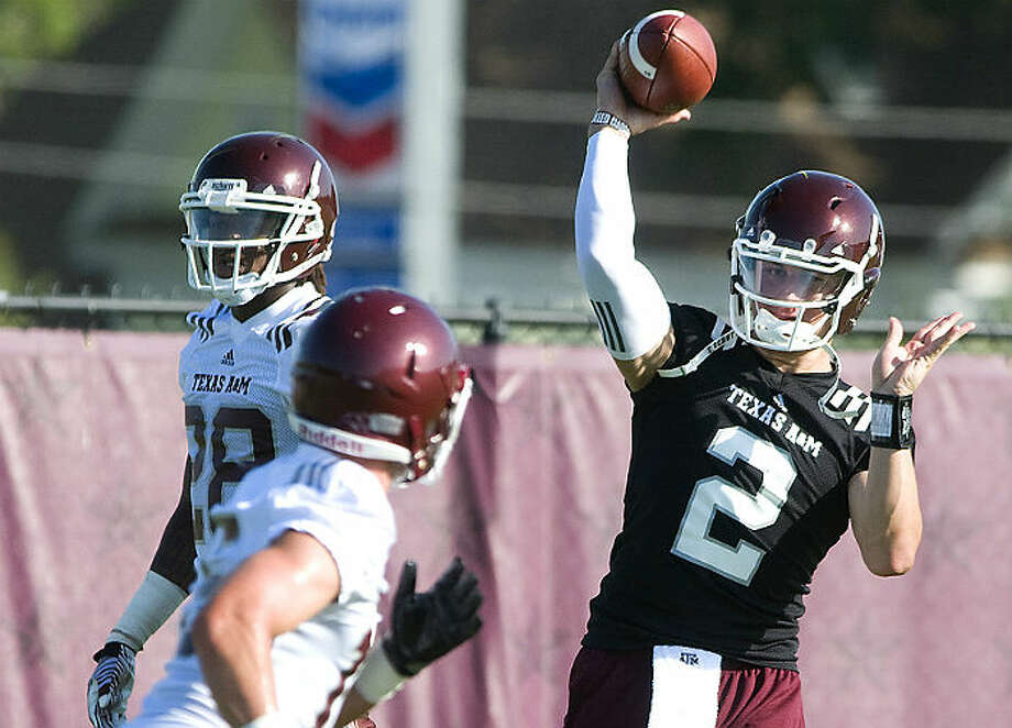 Texas A&M quarterback Johnny Manziel (right) will be playing in his first game since high school when the Aggies make their SEC debut Saturday against Florida. Photo: Associated Press