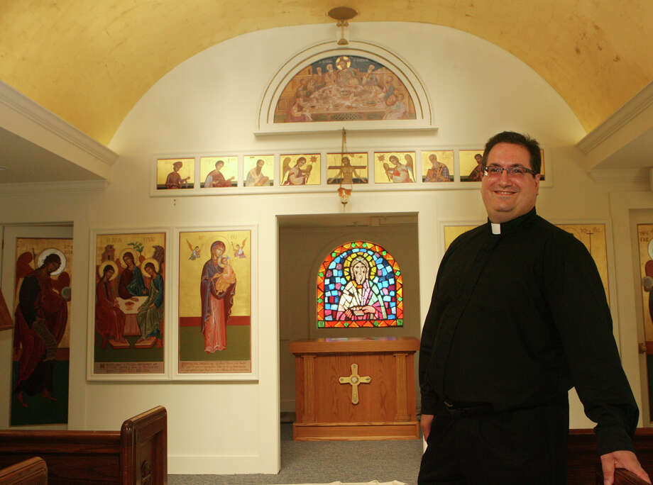 Rev. Peter Orfanakos stands in the new chapel at Saint Barbara's Greek Orthodox Church in Orange, Conn. on Monday, September 3, 2012. Saint Barbara's held their annual Odyssey Festival Labor day weekend. Photo: Unknown, B.K. Angeletti / Connecticut Post freelance B.K. Angeletti