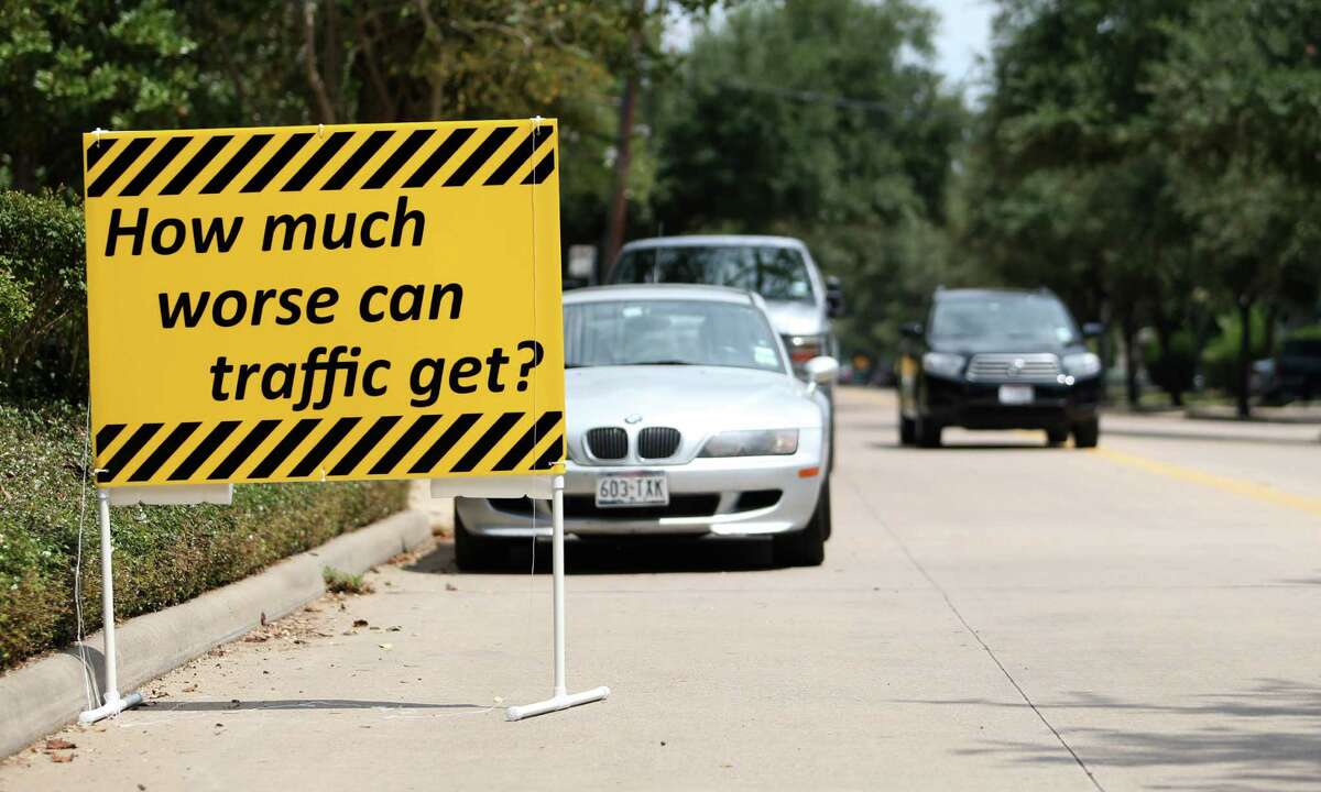 Cars lined up along Bissonnet between Hazard and Mandel, Tuesday, Aug. 28, 2012, in Houston, to protest the Ashby high-rise in an attempt to show how traffic will be affected by the building. ( Karen Warren / Houston Chronicle )