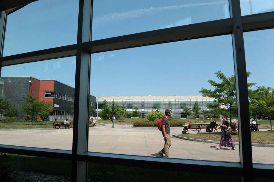 Students make their way between classes on the campus of Hudson Valley Community College on Thursday, Aug. 30, 2012 in Troy, NY.   (Paul Buckowski / Times Union) Photo: Paul Buckowski