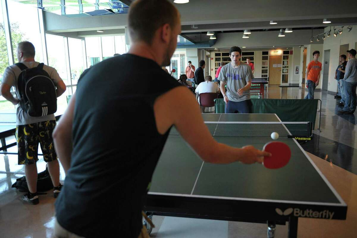 First year students, Joe Toomey, foreground, from Ballston Spa and Mike Pelletier, also from Ballston Spa, play a game of ping pong between classes on the campus of Hudson Valley Community College on Thursday, Aug. 30, 2012 in Troy, NY. (Paul Buckowski / Times Union)
