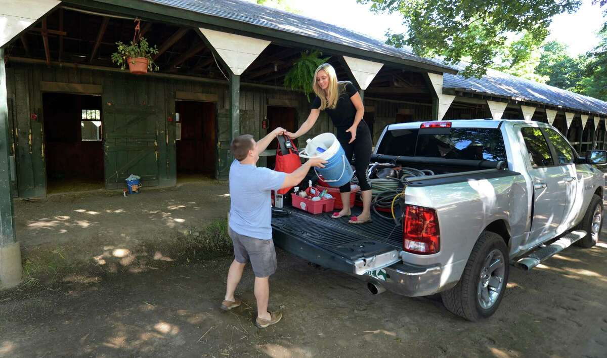 Norman and Melanie Casse load up their remaining gear after shipping their horses from the Saratoga Race Course in Saratoga Springs, N.Y. Sept. 2, 2012. They will continue their training regiment at Churchill Downs for the fall meeting in Louisville, Kentucky (Skip Dickstein/Times Union)