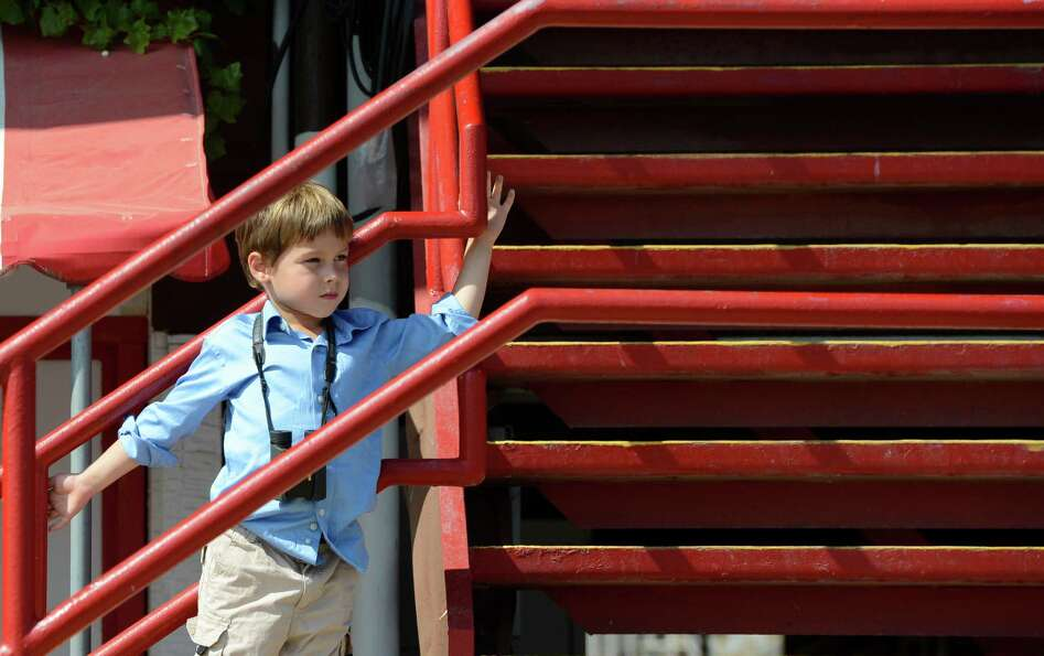 Josiah Hyman 4, of voorheesville enjoys the final day of the 2012 meeting of the Saratoga Race Cours