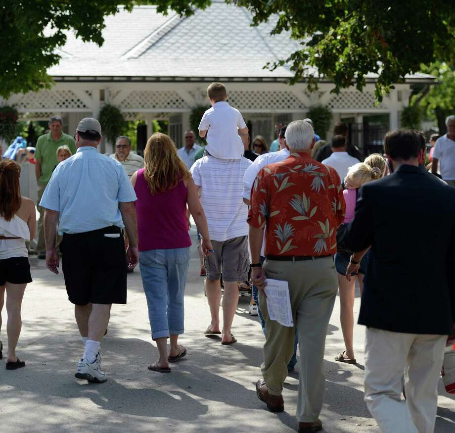 Patrons head for the gate on the final day of the 2012 race meeting at the Saratoga Race Course in Saratoga Springs, N.Y. Sept. 2, 2012.  (Skip Dickstein/Times Union) Photo: Skip Dickstein / 00019066A