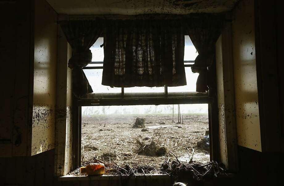 BRAITHWAITE, LA - SEPTEMBER 03:  The view from the kitchen in the Martinez flooded home in Plaquemines Parish on September 3, 2012 in Braithwaite, Louisiana. Melanie Martinez, along with her husband and mother, was forced to ride out the storm in the home when their car broke down. The house quickly flooded and they were rescued by a neighbor who was able to break into their attic to save them. Melanie has lost five homes to hurricanes in Louisiana. Damage totals from the hurricane could top $2 billion and more than 125,000 customers are still without power six days after the storm made landfall.   (Photo by Mario Tama/Getty Images) Photo: Mario Tama, Getty Images