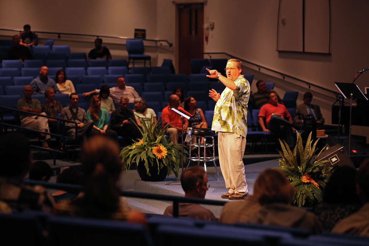 Harvest Fellowship Community Church Interim Pastor Darryl Lindsey preaches during Sunday Service, Sept. 2, 2012. Once a community of 3,000 members, the numbers have dwindled to around 200 and the church sold its building near the corner of US 281 North and Loop 1604 to pay off its debt.