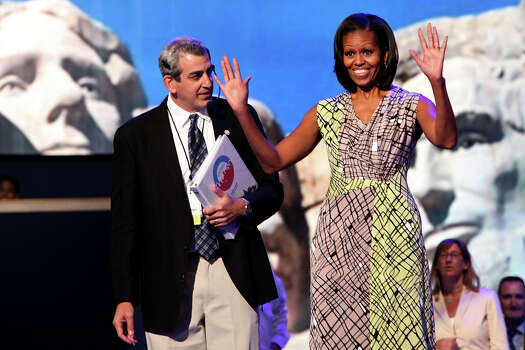 First Lady Michelle Obama, with stage manager David Cove, takes the stage for a walk-through of her speech in preparation for the start of the Democratic National Convention in Charlotte, NC on Monday, Sept. 3, 2012. Photo: Lisa Krantz, San Antonio Express-News / San Antonio Express-News