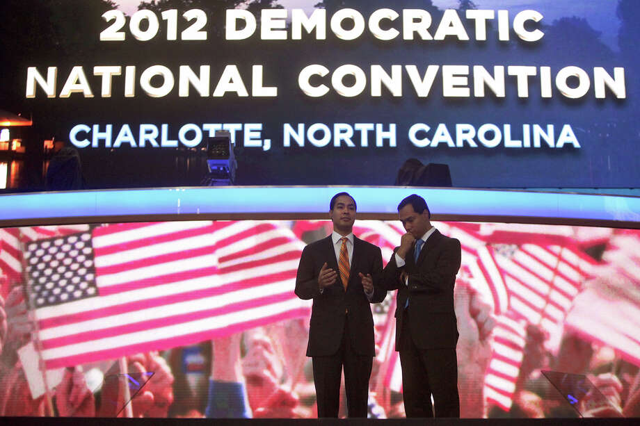 Mayor Julian Castro, left, with his brother, Joaquin Castro, survey the scene inside Time Warner Arena from the stage as they prepare for the Democratic National Convention in Charlotte, NC on Monday, Sept. 3, 2012. Photo: Lisa Krantz, San Antonio Express-News / San Antonio Express-News