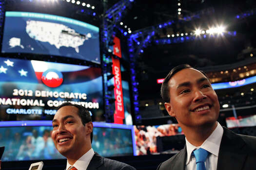 Mayor Julian Castro, left, with his brother, Joaquin Castro, look out at the expanse of Time Warner Cable Arena as they are interviewed during preparations for the Democratic National Convention in Charlotte, NC on Monday, Sept. 3, 2012. Photo: Lisa Krantz, San Antonio Express-News / San Antonio Express-News
