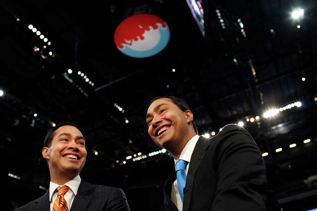 Mayor Julian Castro, left, with his brother, Joaquin Castro, sit for a television interview at Time Warner Cable Arena as they prepare for the Democratic National Convention in Charlotte, NC on Monday, Sept. 3, 2012. Photo: Lisa Krantz, San Antonio Express-News / San Antonio Express-News