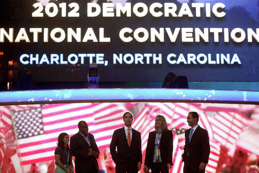 Mayor Julian Castro, center, with his brother, Joaquin Castro, right, look out at the expanse of Time Warner Arena from the stage as they prepare for the Democratic National Convention in Charlotte, NC on Monday, Sept. 3, 2012. Photo: Lisa Krantz, San Antonio Express-News / San Antonio Express-News