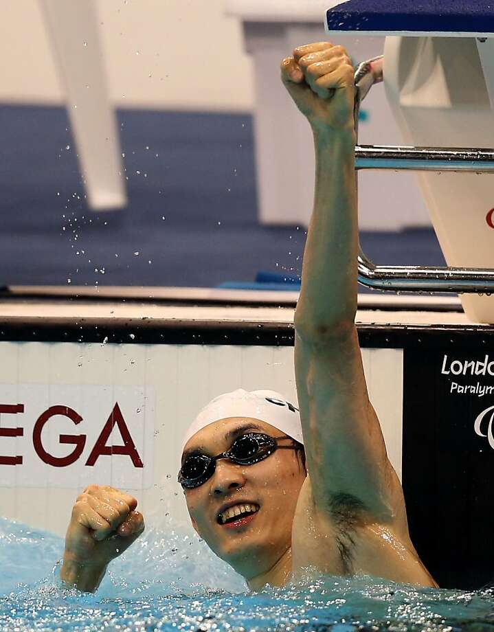 LONDON, ENGLAND - SEPTEMBER 03:  Bozun Yang of China celebrates after winning gold in the Men's 100m Breaststroke - SB11 final on day 5 of the London 2012 Paralympic Games at Aquatics Centre on September 3, 2012 in London, England.  (Photo by Scott Heavey/Getty Images) Photo: Scott Heavey, Getty Images