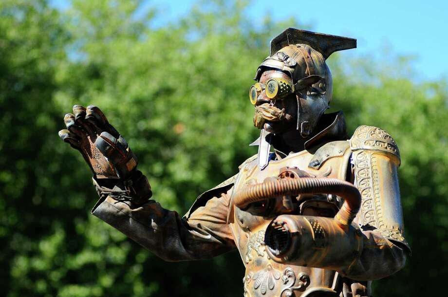 A man dressed as a statue strikes a pose for spectators at Bumbershoot. Photo: LINDSEY WASSON / SEATTLEPI.COM