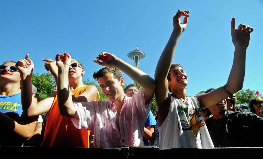 A group of guys rock out to Bombino at the TuneIn Stage on the Fisher Green at Bumbershoot. Photo: LINDSEY WASSON / SEATTLEPI.COM