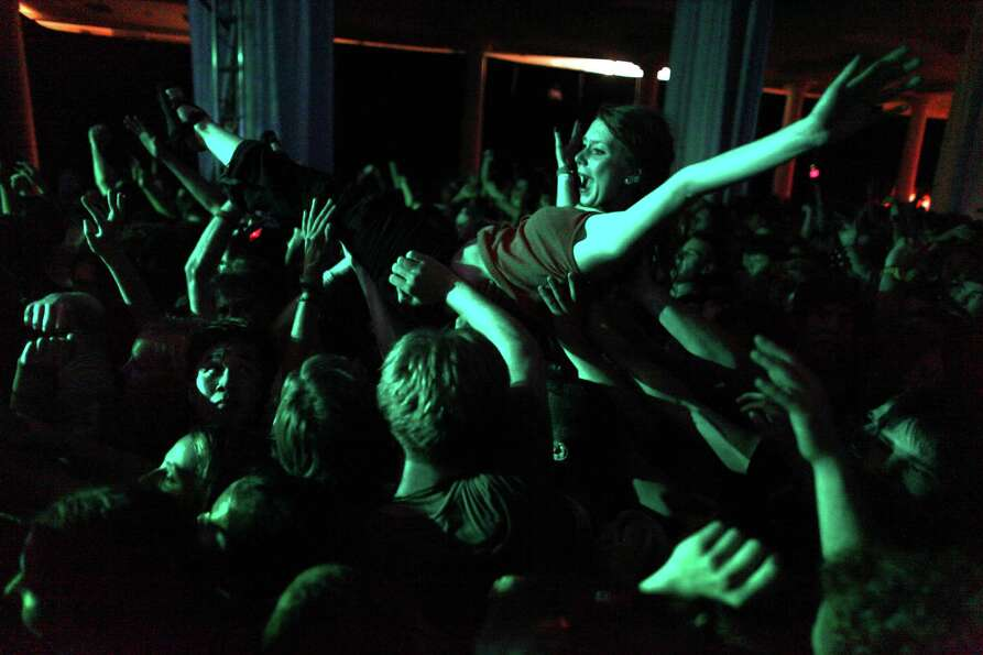 A girl crowd surfs during a performance by The Wombats on the Exhibition Hall Stage.