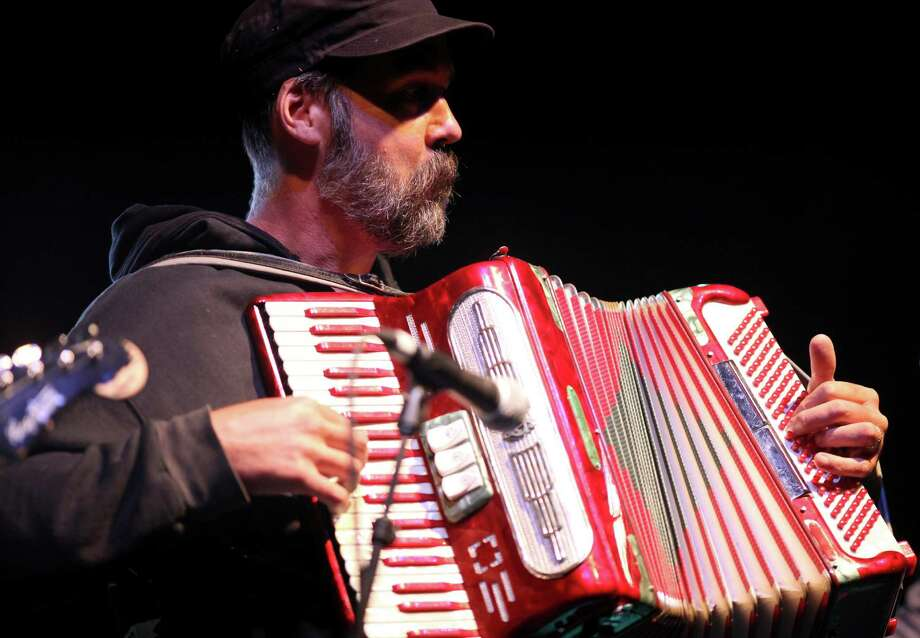 Guest musician Krist Novoselic performs on the accordion with The Vaselines on the Sub Pop Stage during the final day of the Bumbershoot. Photo: JOSHUA TRUJILLO / SEATTLEPI.COM