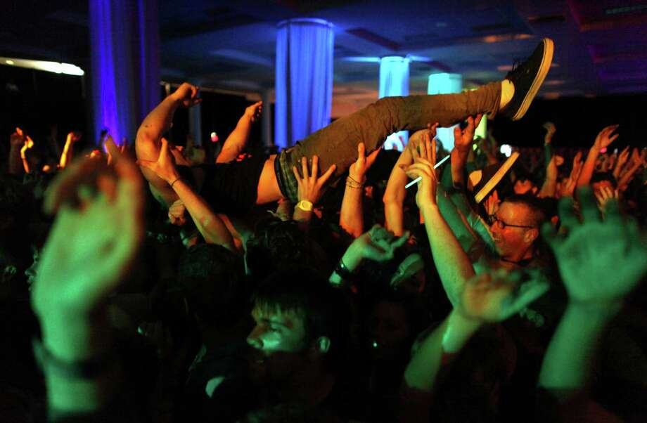 A person crowd surfs during a performance by The Wombats on the Exhibition Hall Stage. Photo: JOSHUA TRUJILLO / SEATTLEPI.COM